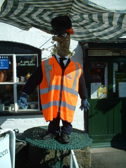 Scarecrow Contest - September 2009: A Scarecrow Outside the Village Shop & Post Office  © A. Roberts