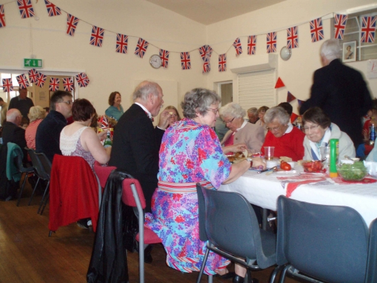 Jubilee Celebrations (June 2012): Everyone tucked-in at the Jubilee Picnic (unfortunately held inside the Coronation Hall due to the poor weather)
